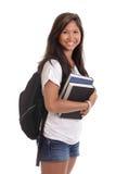 Żeński Azjatycki uczeń z książkami i plecakiem Zdjęcia Royalty Free