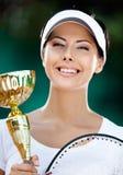 Żeński gracz w tenisa wygrywał dopasowanie Fotografia Stock