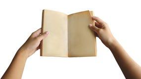 Żeńskiego ręki mienia Pusty Book/Podrzuca stronę na Białym tle - rocznik Papierowa tekstura Obrazy Royalty Free