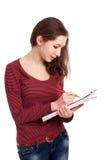 Żeńskiego ucznia writing na schowku obrazy royalty free