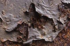 Żelazna tekstura z korodowaniem i dziura w nim fotografia stock