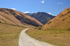Żwir droga góry, Nowa Zelandia, Queenstown obraz stock