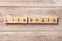 ŻYCIE celów słowo pisać na drewnianym bloku ŻYCIE celów tekst na stole, pojęcie Obrazy Stock