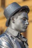 Żywa statua mężczyzna, osrebrza ubiera Obrazy Royalty Free