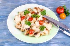 Żywienioniowy naczynie kalafior z pomidorami obrazy stock