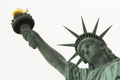 Άγαλμα στενού επάνω ελευθερίας στο πρόσωπο και το βραχίονα Στοκ Εικόνες