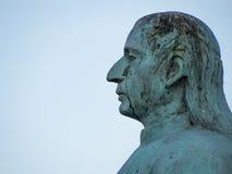 Άγαλμα ενός καθισμένου ατόμου στοκ εικόνα