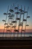 Άγαλμα ομπρελών στα χρώματα του ηλιοβασιλέματος, Θεσσαλονίκη στοκ φωτογραφία