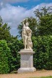 Άγαλμα Bacchus με το σταφύλι στους κήπους των Βερσαλλιών Στοκ Εικόνες