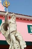 Άγαλμα Cupids - με τα ρόδινα κτήρια. Στοκ Εικόνες