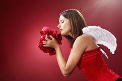 Άγγελος και λουλούδια Στοκ Εικόνες
