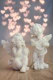 Άγγελοι και bokeh καρδιές Στοκ Φωτογραφίες
