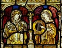 Άγγελοι που κάνουν τη μουσική (λεκιασμένο γυαλί) στοκ φωτογραφίες με δικαίωμα ελεύθερης χρήσης