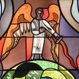 Άγγελος στο λεκιασμένο παράθυρο Στοκ Εικόνες