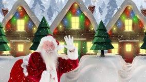 Άγιος Βασίλης τα διακοσμημένα σπίτια που συνδυάζονται μπροστά από με το μειωμένο χιόνι απεικόνιση αποθεμάτων