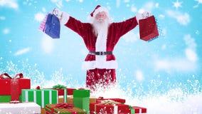 Άγιος Βασίλης τα χριστουγεννιάτικα δώρα που συνδυάζονται με με το μειωμένο χιόνι απεικόνιση αποθεμάτων