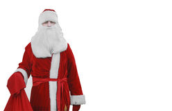 Άγιος Βασίλης, Άγιος Βασίλης είναι στα ξύλα με μια τσάντα των δώρων Στοκ Φωτογραφίες