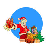 Άγιος Βασίλης δίνει τα δώρα Στοκ εικόνα με δικαίωμα ελεύθερης χρήσης