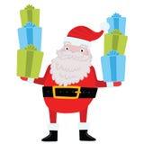 Άγιος Βασίλης με τα δώρα και παρουσιάζει. Στοκ Εικόνες