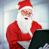 Άγιος Βασίλης με το lap-top Στοκ Εικόνα