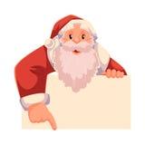 Άγιος Βασίλης που κοιτάζει από πίσω από τον τοίχο και που παρουσιάζει κάτι απεικόνιση αποθεμάτων