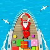 Άγιος Βασίλης που κολυμπά σε ένα γιοτ Στοκ Φωτογραφία