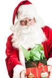 Άγιος Βασίλης που κρατά ένα δώρο Στοκ Φωτογραφία