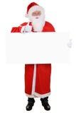Άγιος Βασίλης που κρατά τους κενούς αντίχειρες σημαδιών επάνω στο έξοχο αγαθό Χριστουγέννων Στοκ εικόνα με δικαίωμα ελεύθερης χρήσης