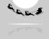 Άγιος Βασίλης που πετά με τα ελάφια Στοκ Φωτογραφίες
