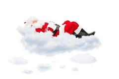 Άγιος Βασίλης που στηρίζεται στο σύννεφο Στοκ Εικόνες