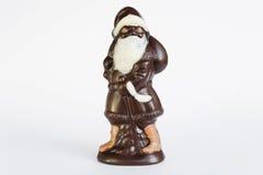 Άγιος Βασίλης, σοκολάτα, στην κόκκινη τσάντα, μελαχροινή σοκολάτα Στοκ Φωτογραφία