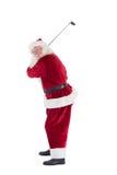 Άγιος Βασίλης ταλαντεύεται το γκολφ κλαμπ του Στοκ φωτογραφίες με δικαίωμα ελεύθερης χρήσης