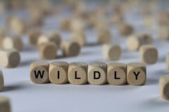 Άγρια - κύβος με τις επιστολές, σημάδι με τους ξύλινους κύβους Στοκ Φωτογραφία