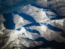 Άλπεις από το παράθυρο αεροπλάνων στοκ εικόνα
