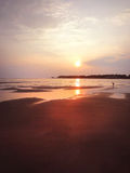 Άμμος, ηλιοβασίλεμα παραλιών Στοκ Φωτογραφίες
