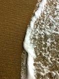 Άμμος και κύματα Στοκ Εικόνες