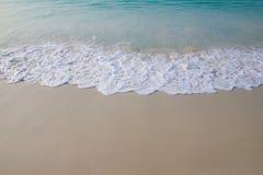 Άμμος και κύμα Στοκ Εικόνες