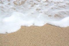 Άμμος και seafoam στοκ εικόνες