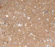 Άμμος με το αμμοχάλικο ως υπόβαθρο στοκ φωτογραφία