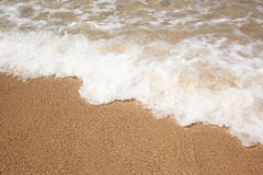 Άμμος παραλιών και θαλάσσιο νερό Στοκ φωτογραφία με δικαίωμα ελεύθερης χρήσης