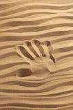 άμμος τυπωμένων υλών χεριών στοκ φωτογραφίες