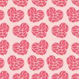 Άνευ ραφής αφηρημένο υπόβαθρο των καρδιών σε ένα ρόδινο υπόβαθρο Στοκ εικόνες με δικαίωμα ελεύθερης χρήσης