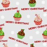 Άνευ ραφής διανυσματικό σχέδιο με τα Χριστούγεννα cupcakes Στοκ Φωτογραφίες