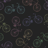 Άνευ ραφής πολύχρωμο σχέδιο των εκλεκτής ποιότητας ποδηλάτων Στοκ Φωτογραφία