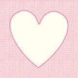 Άνευ ραφής πλεκτό σχέδιο με διαμορφωμένο το καρδιά πλαίσιο για το κείμενο Στοκ Εικόνα