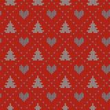 Άνευ ραφής σκανδιναβικό πλέκοντας διανυσματικό σχέδιο Χριστουγέννων με fir-trees, τις καρδιές και τη διακοσμητική γραμμή Στοκ Εικόνες