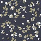 Άνευ ραφής σχέδιο με τα λουλούδια και τα φύλλα που απομονώνονται στο μπλε backgr Στοκ Φωτογραφία