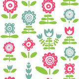 Άνευ ραφής σχέδιο με τα ρόδινα και μπλε πρωτόγονα λουλούδια Στοκ φωτογραφία με δικαίωμα ελεύθερης χρήσης