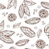 Άνευ ραφής σχέδιο με τους λοβούς, τα φασόλια και τα φύλλα κακάου απεικόνιση αποθεμάτων