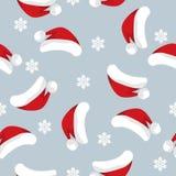 Άνευ ραφής σχέδιο περιόδου διακοπών Χριστουγέννων με το καπέλο και snowflakes Santa απεικόνιση αποθεμάτων